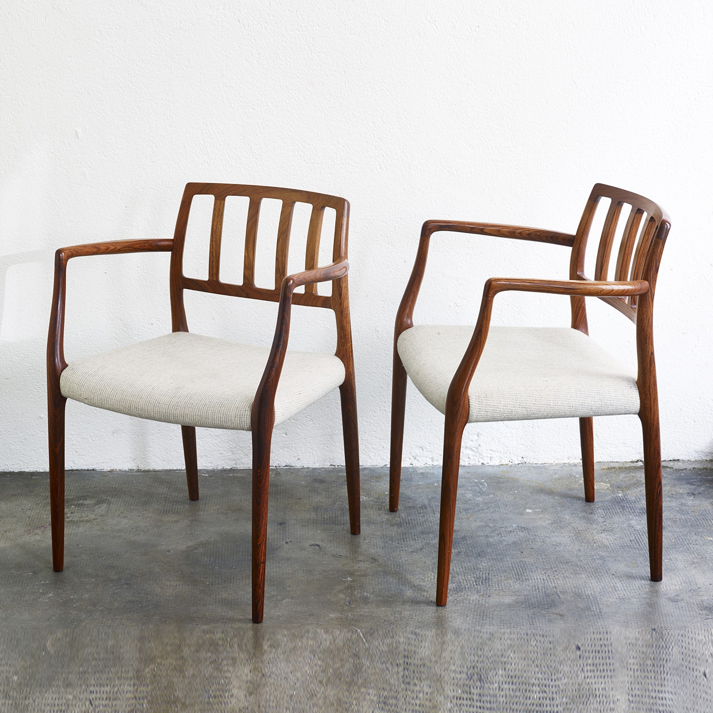 pair-of-rosewood-niels-moller-mod-66-chairs-image-01